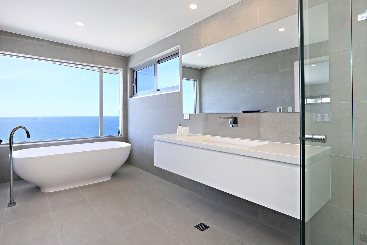 Bathtub with picture window views of the ocean