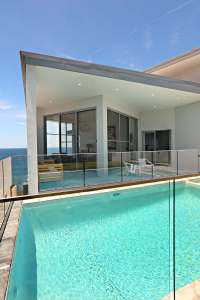 outdoor pool deck area Waterfront Elegance home for rent Sydney
